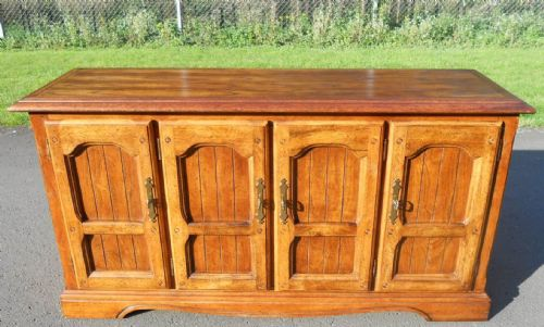 Four Door Panelled Oak Sideboard